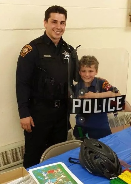 Crime Prevention Officer Robert Petersen and a Cub Scout