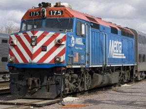 Blue train with red and white stripes on the front